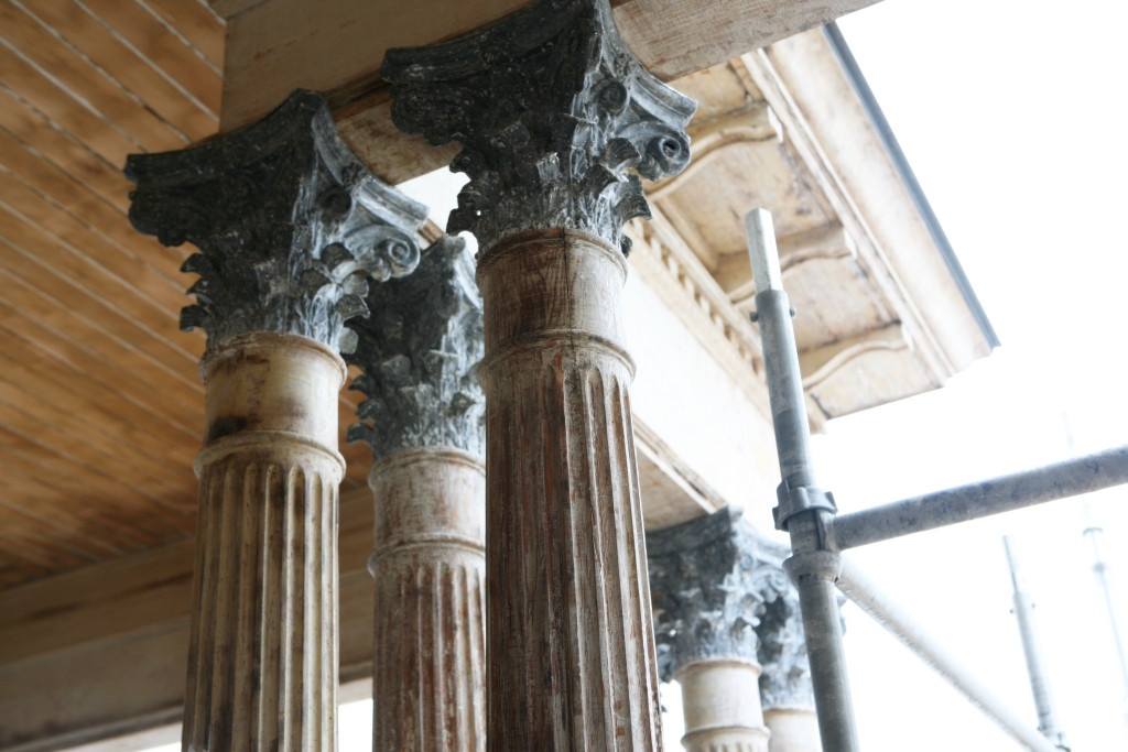 The pillars have been repaired and are being repainted.