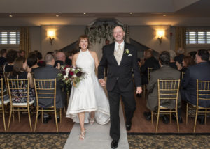 Bride and Groom at Barrington's White House - walking down the aisle